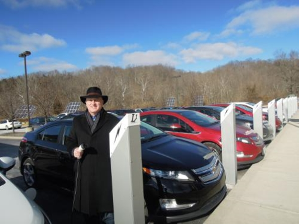 Steve Melink, Melink Corporation founder, standing next to 10 L1 PowerPost(TM) Electric Vehicle Charging Stations at his LEED Platinum and Net-Zero Energy headquarters located in Milford, Ohio, a suburb of Cincinnati.