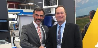 Gregory Erdmann, NRG Systems' VP of Global Sales, and Francisco Torres, Lasser Eólica's CEO
