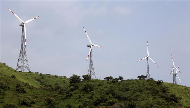 Power-generating windmill turbines are pictured in Suzlon wind farm at Sanodar village