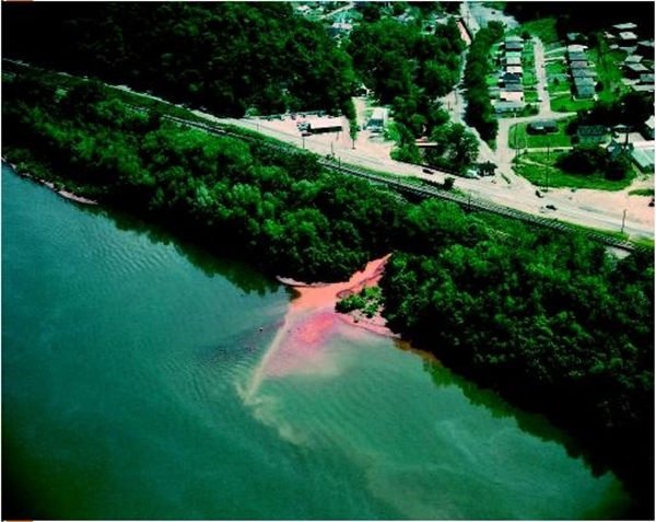 Aerial view of shoreline, showing a stream polluted with waste water runoff from strip mining flowing into the Ohio River (photo courtesy pollution issues)